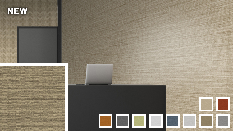 Black desk with laptop in a reception/lobby area with beige Mod Linen wallcoverings.