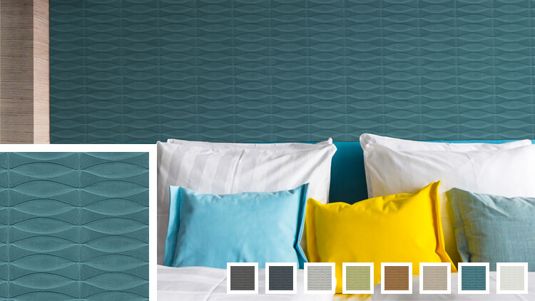 Large bed with white, turqouise, and yellow pillows on a turqouise wall with Volans wallcovering.